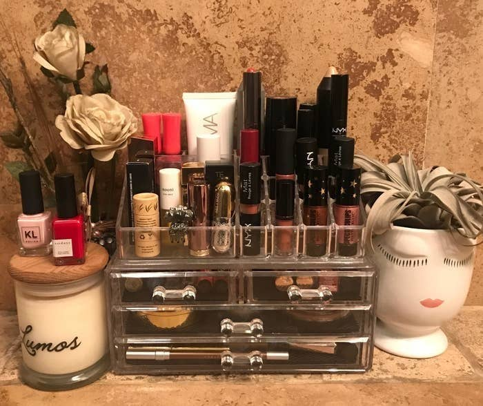 BuzzFeed Editor AnaMaria Glavan's makeup organizer on a bathroom countertop neatly holding various makeup products