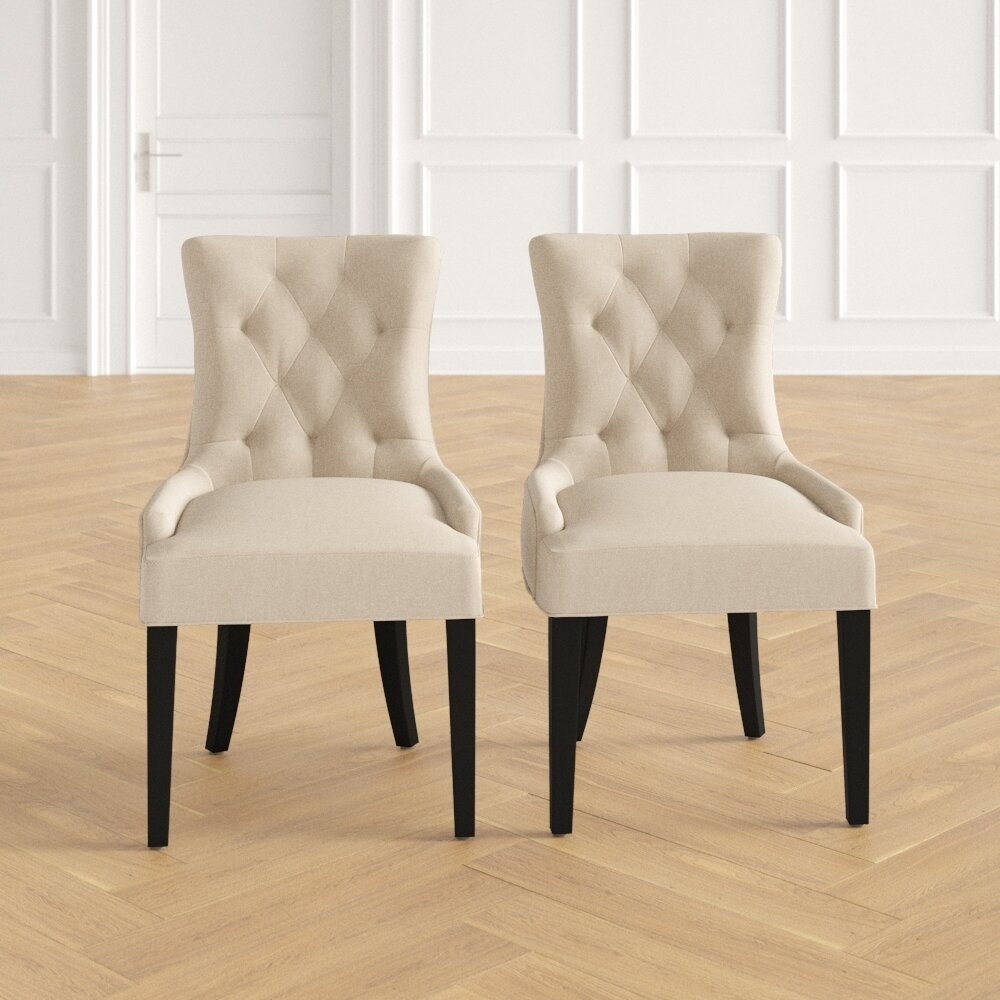 Tufted upholstered dining chairs in beige