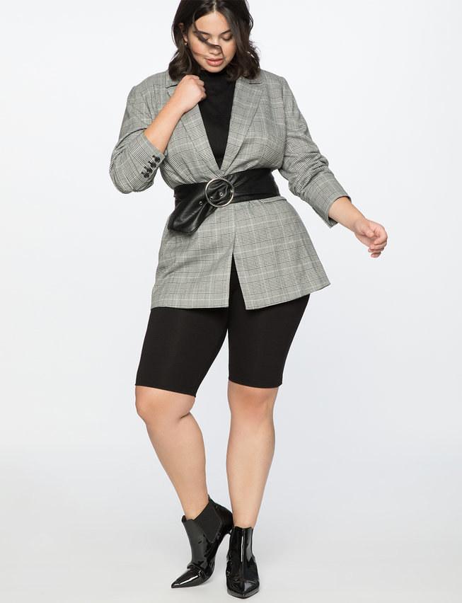 Model wearing the black biker shorts with blazer