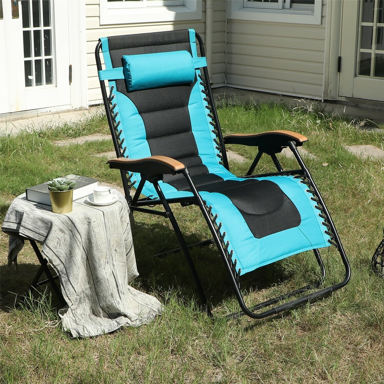 Oversized padded reclining zero gravity chair with added cushioning in aqua and wooden arm rests