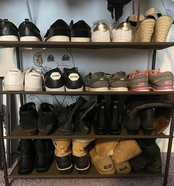 BuzzFeed Editor Samantha Wieder's shoe rack with three tears holding heavier shoes like boots and running sneakers