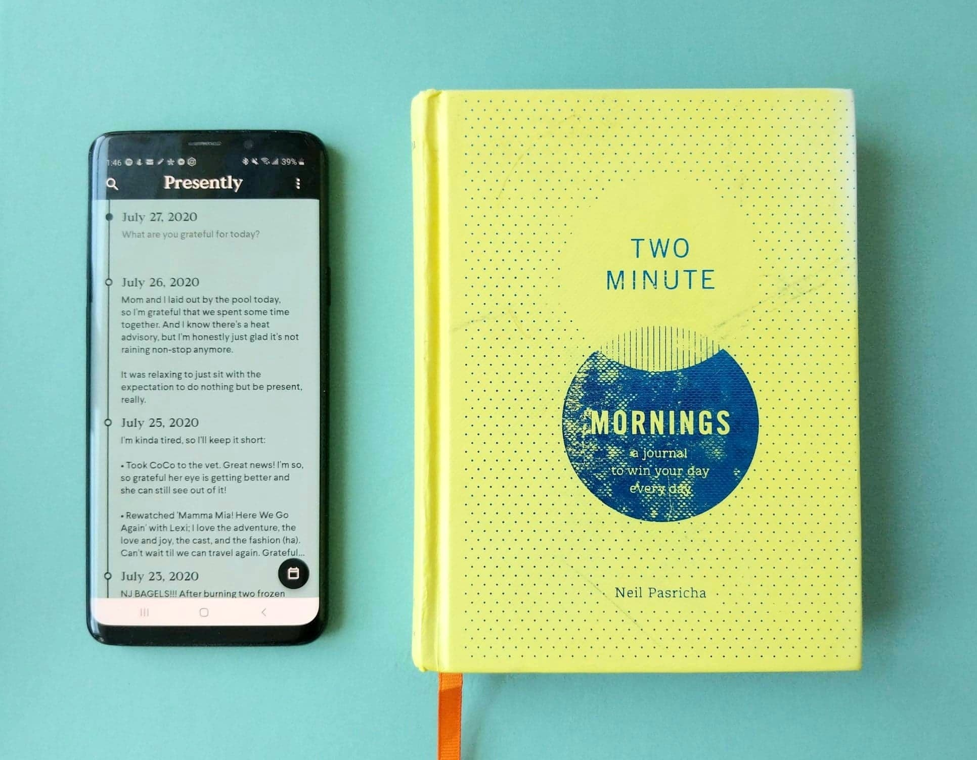 The phone with the presently app laid out next to the Two Minute Morning journal