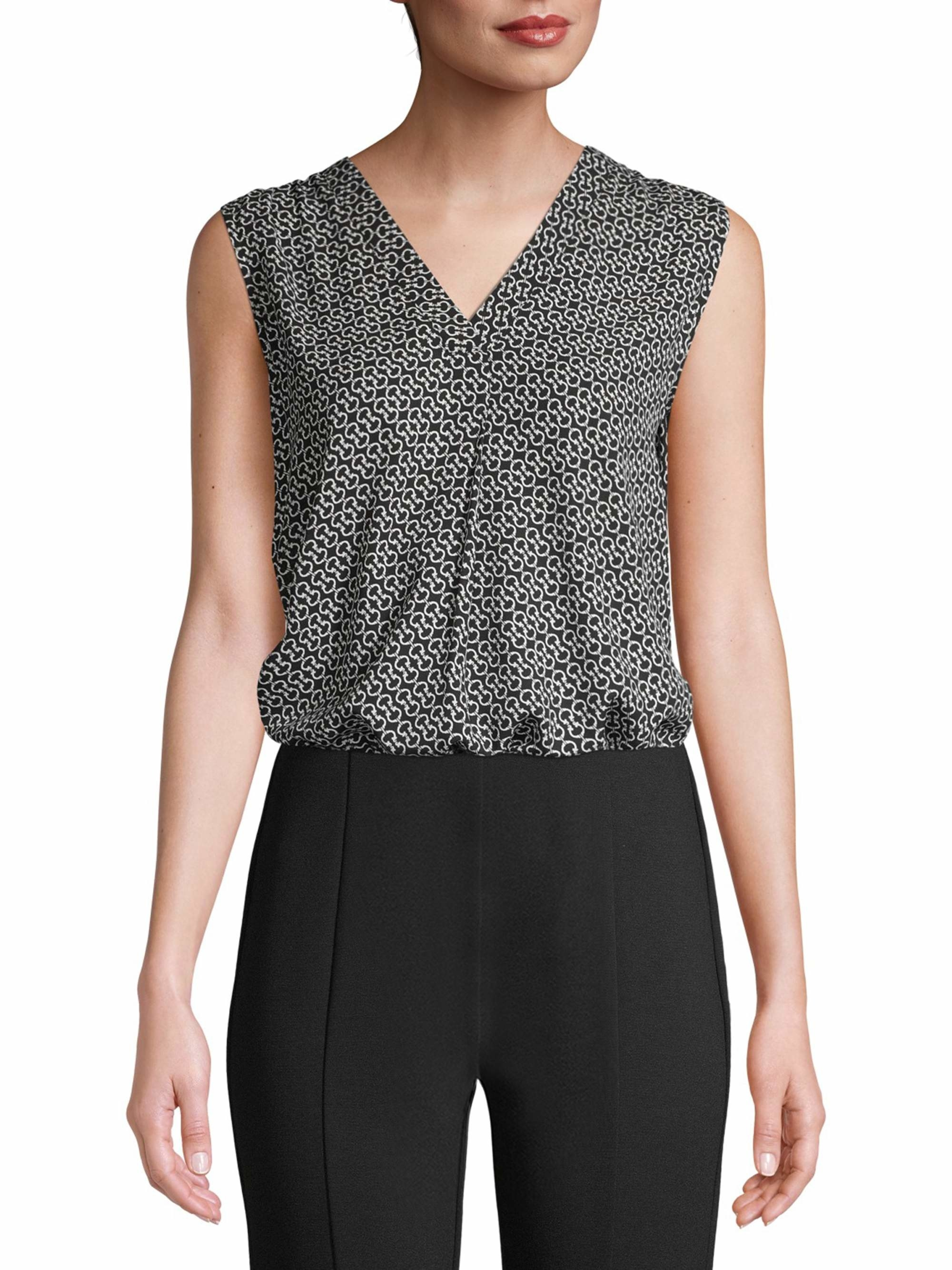 the sleeveless v-neck blouse with a black and white pattern on it