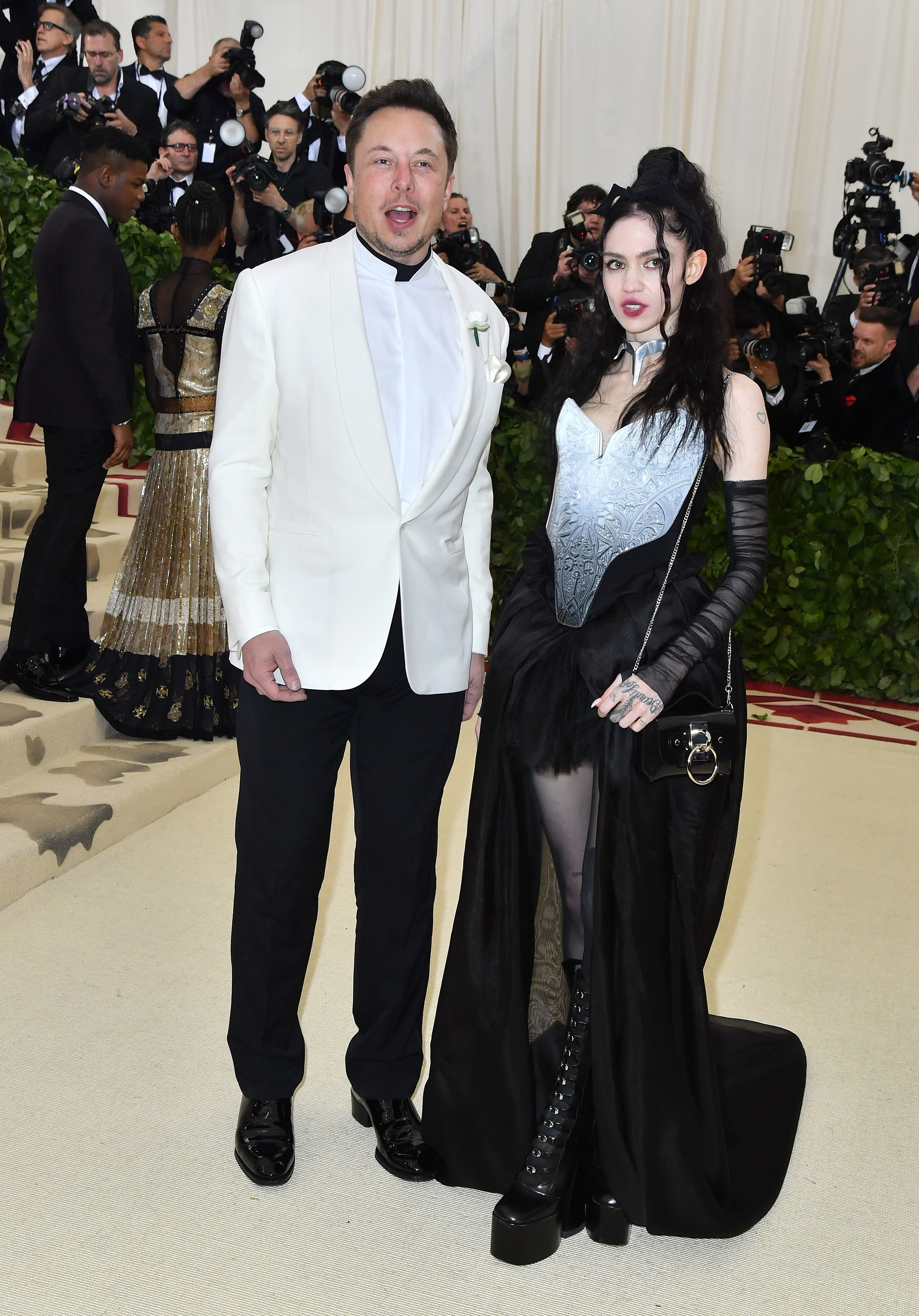 Grimes and Elon Musk on a red carpet