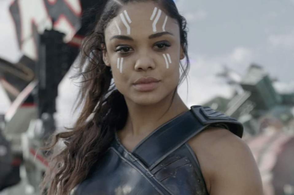 Valkyrie staring with a serious expression on her face, wearing her armor, prepared to fight
