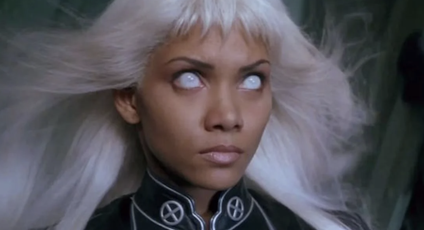 Storm creating a storm with a determined expression on her face, hair flowing and pupils nowhere to be seen