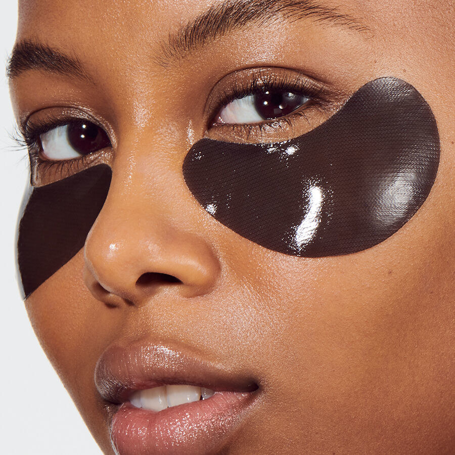 A model wearing the curved patches under their eyes