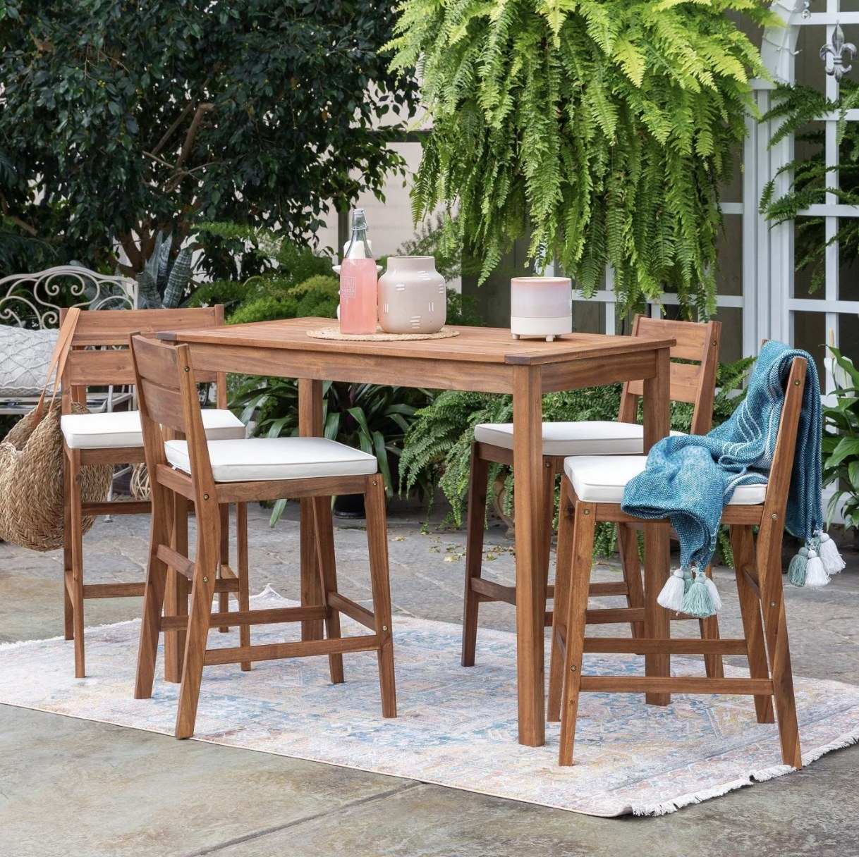the brown dining table and four matching chairs