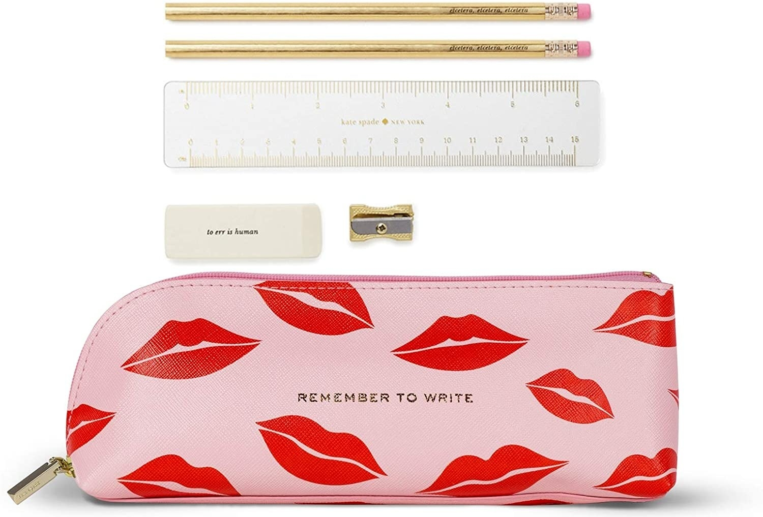 A small leather pencil case with two pencils, a ruler, an eraser, and a pencil sharpener beside it