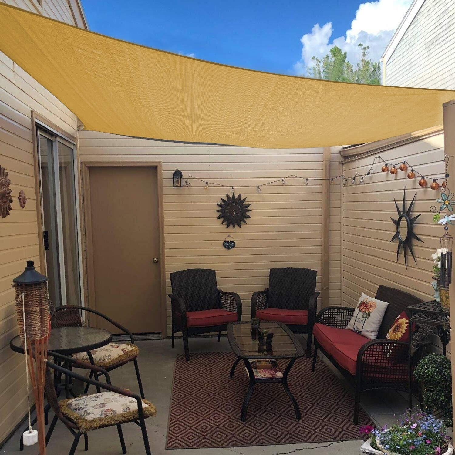 A beige canopy shade over a small outdoor porch