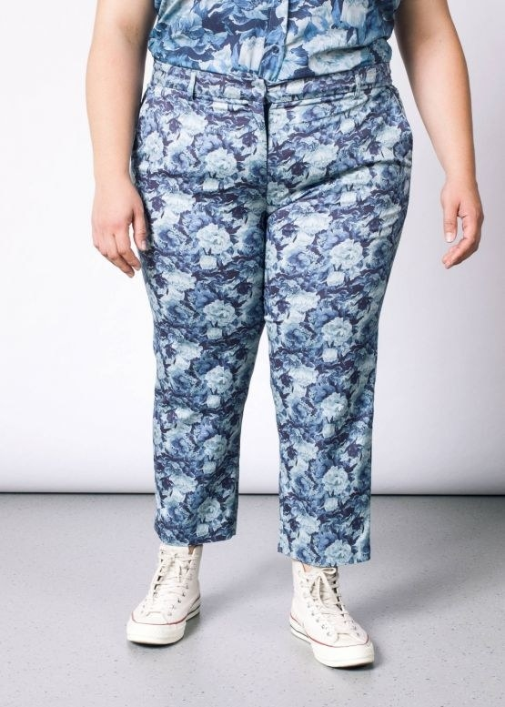 Blue floral crop pants paired with high top Converse