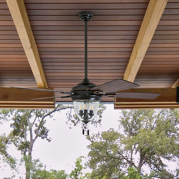 a ceiling fan with wooden panels and a mini chandelier inside