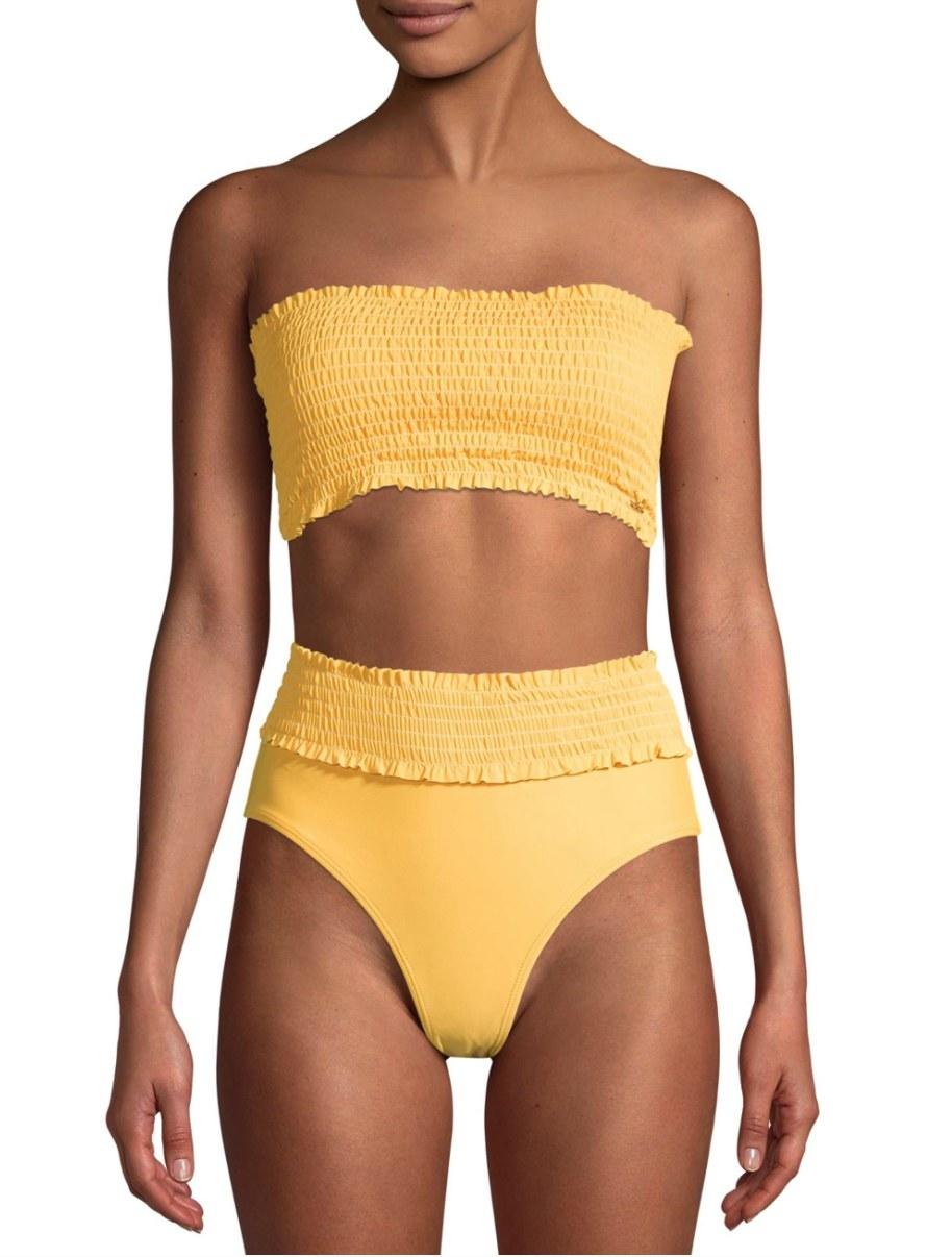 Model in a yellow bikini