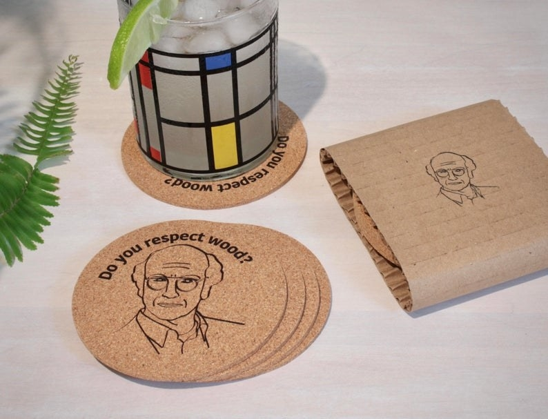 "The stack of round coasters with Larry David's face and the phrase ""Do you respect wood?"" on them"