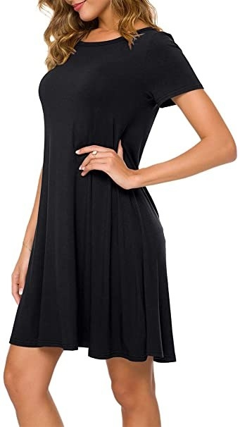 model wearing short sleeve scoop neck T-shirt dress that hits above the knee