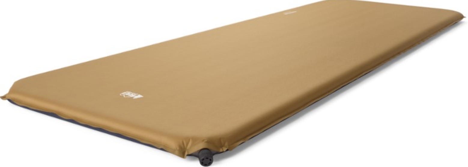 1.5 inch thick tan sleeping mat with valve on the corner