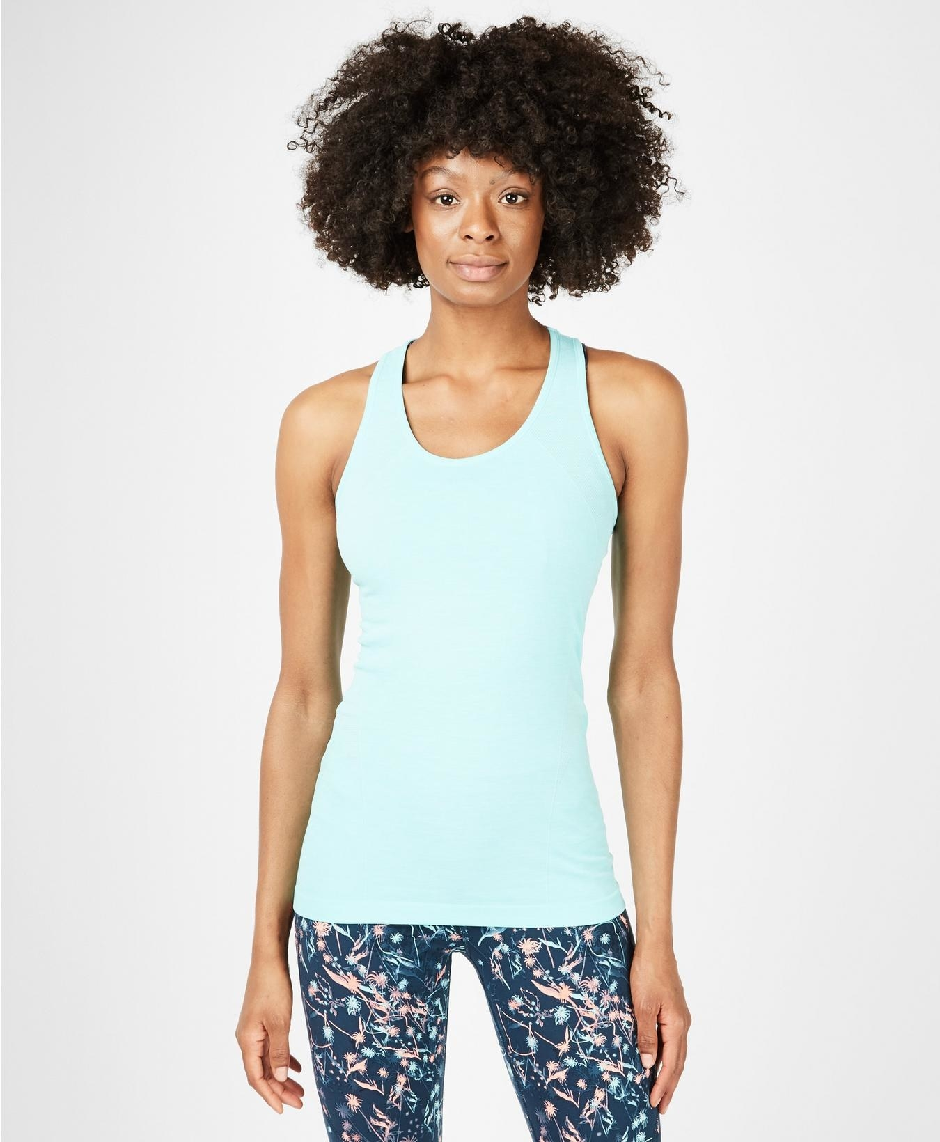 Model wearing the fitted tank top in light blue
