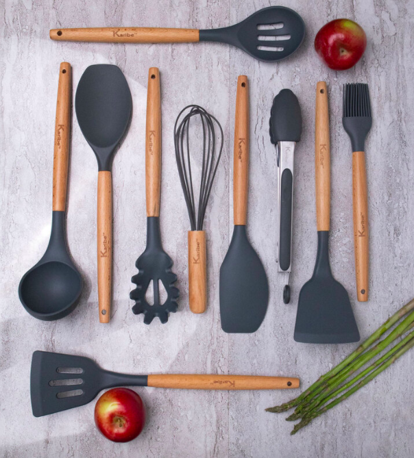 A wooden, scratch-resistant utensils set with a spatula, soup spoon, whisk, tongs, and more cooking essentials