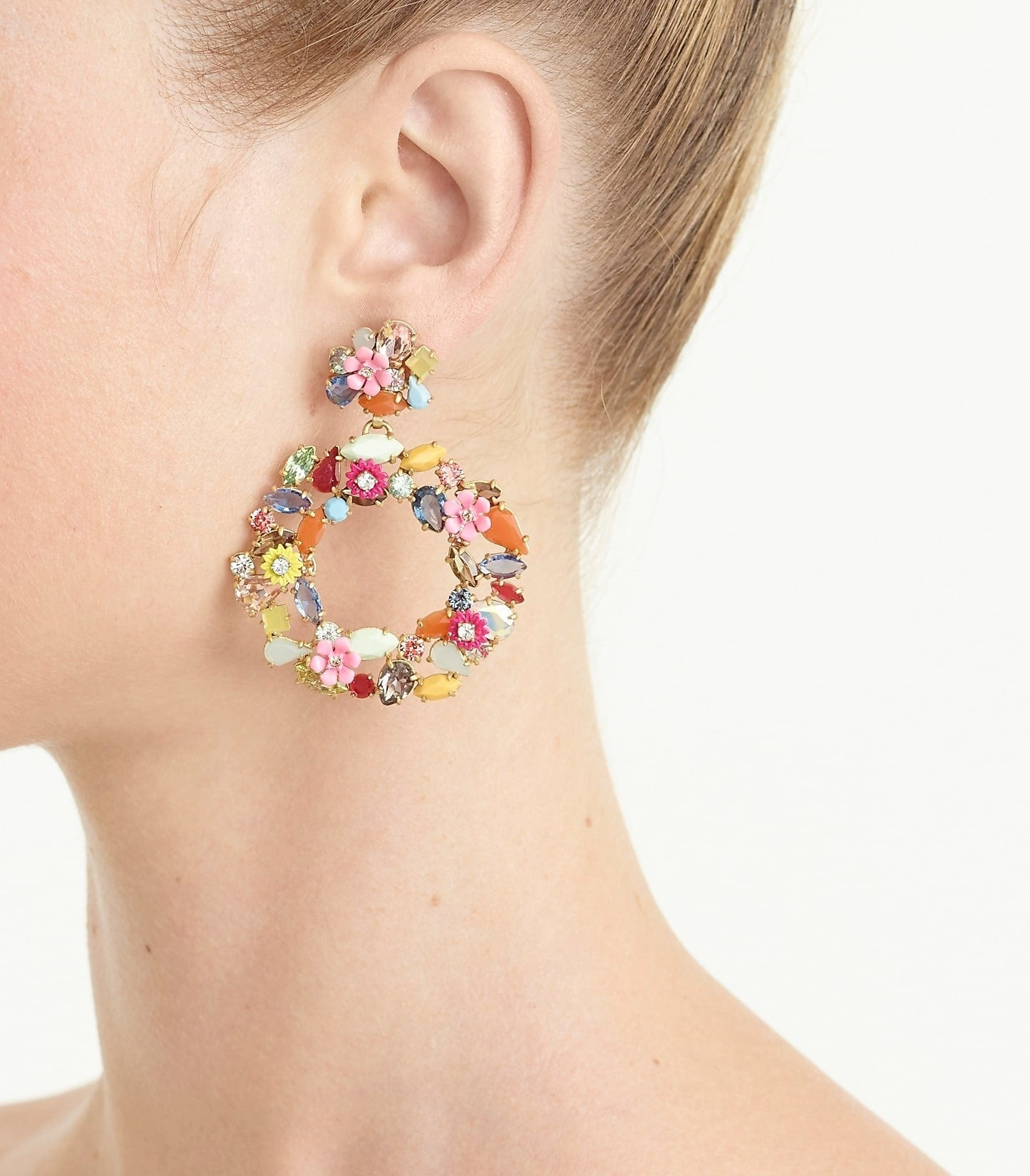 A model wearing the colorful gemstone and flower circle drop earrings