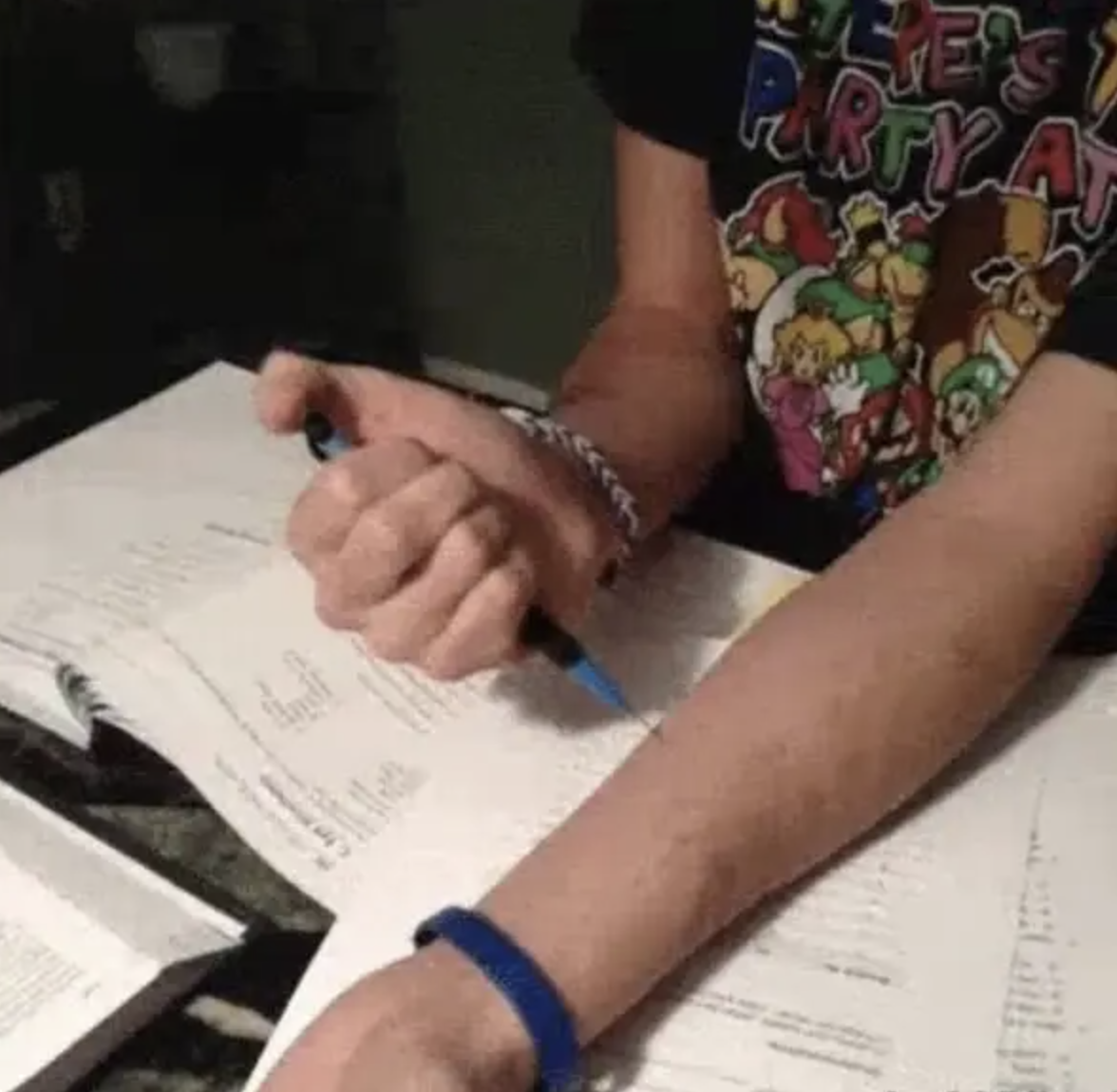 Kid stabbing himself with a mechanical pencil