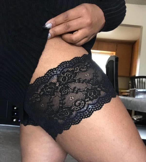 A reviewer wearing the black lace chafing bands
