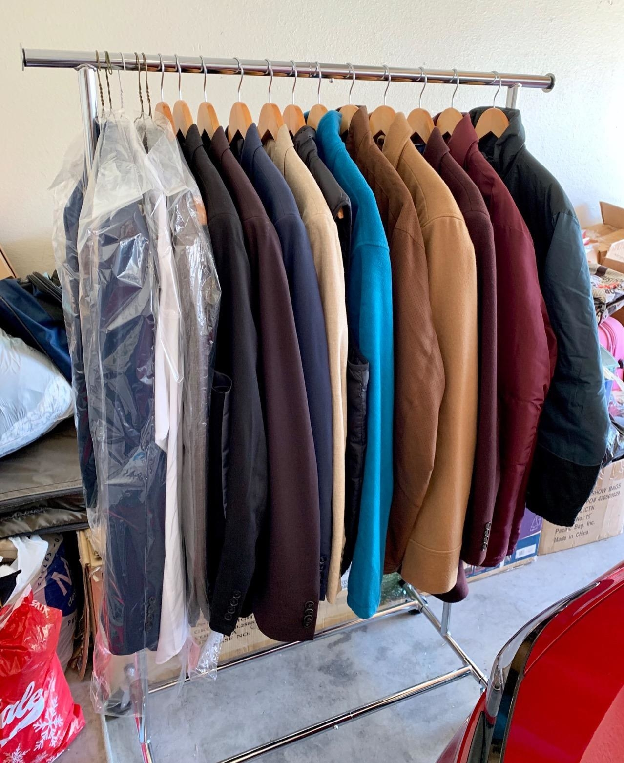 A reviewer's photo of more than a dozen jackets hung from the metallic garment rack