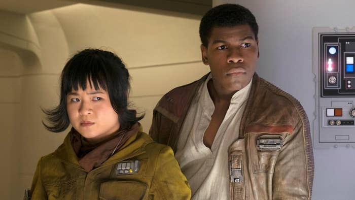 Kelly Marie Tran as Rose and John Boyega as Finn standing next to each other both looking worried.