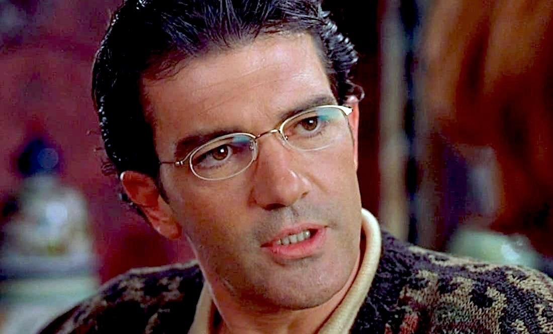 A close up of Antonio Banderas in a glasses and a dad sweater from Spy Kids