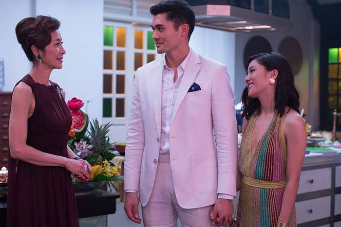 Michelle Yeoh as Eleanor talking to her son Nick (Henry Golding) and his girlfriend Rachel (Constance Wu) at a party.