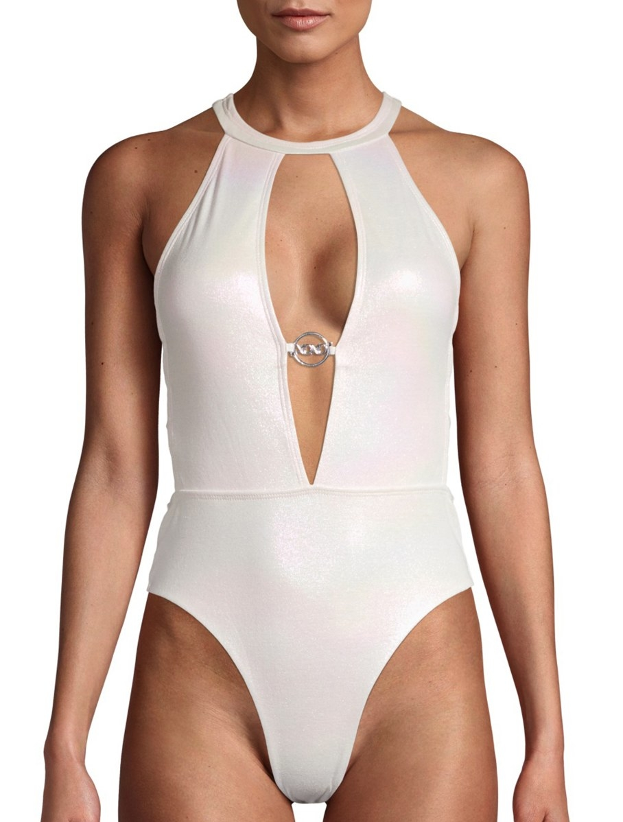 Model in a a shimmery plunge ivory one-piece