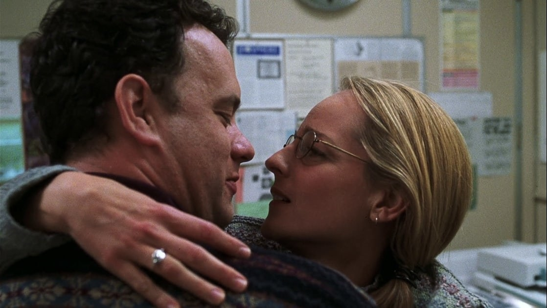 Tom Hanks as Chuck and Helen Hunt as Kelly holding each other and about to kiss.