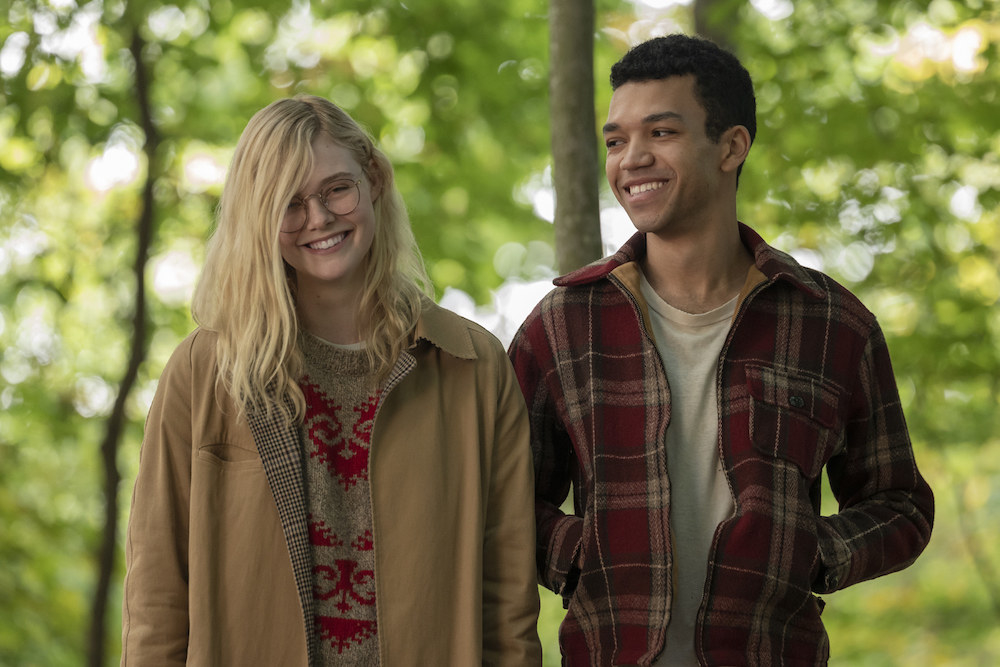 Elle Fanning as Violet smiles and walks side-by-side with Theodore (Justice Smith).