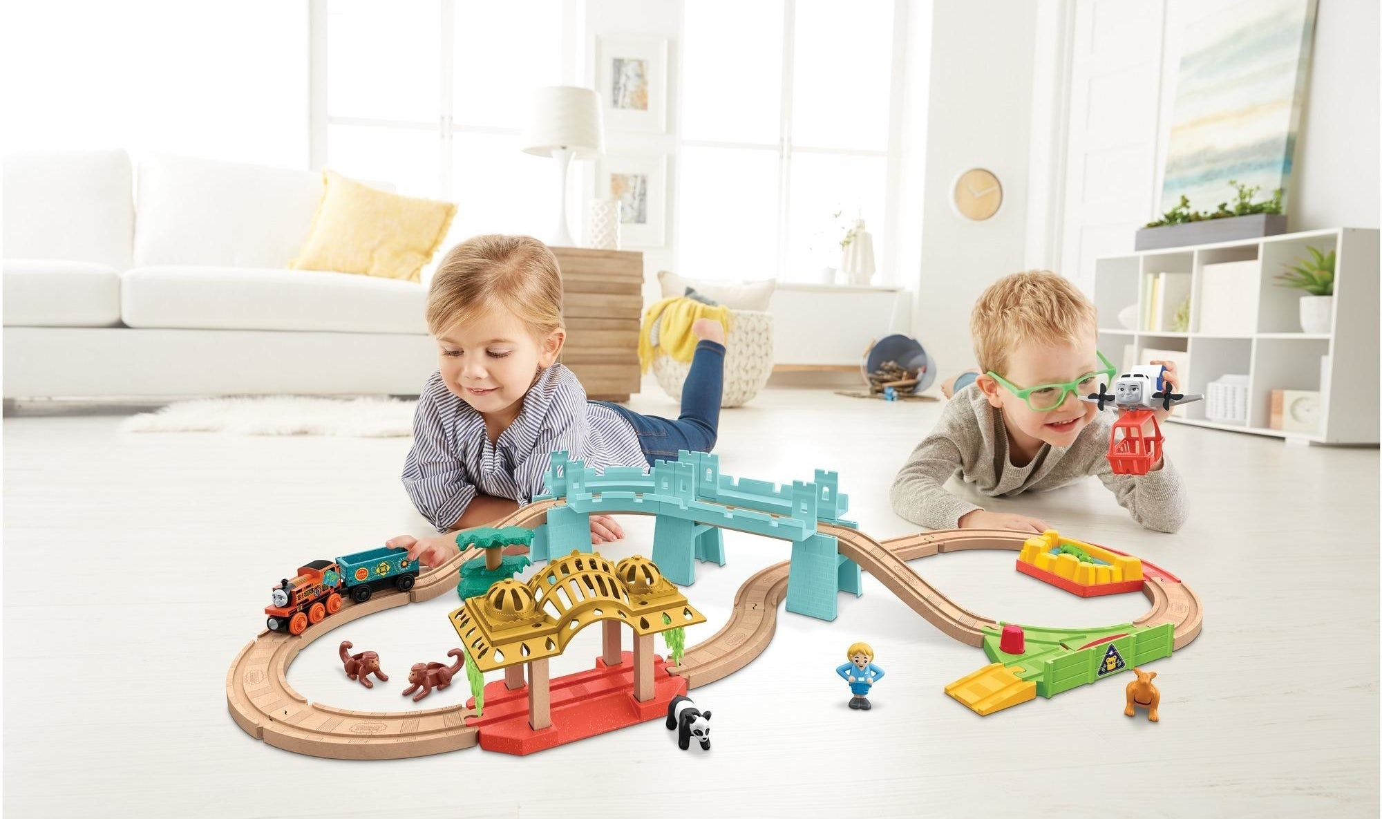 two kids playing with the train set