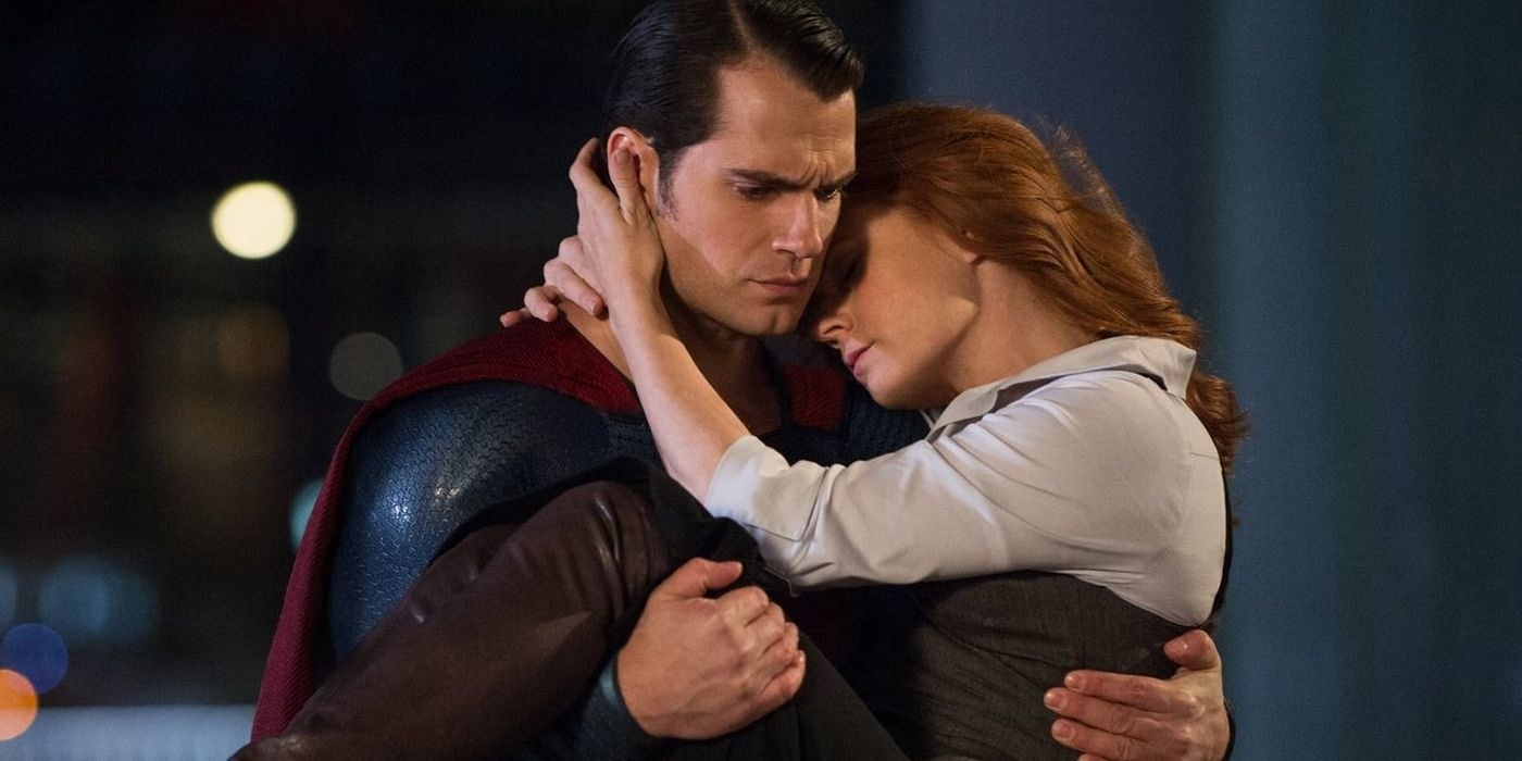 Henry Cavill as Superman carries Lois Lane (Amy Adams).