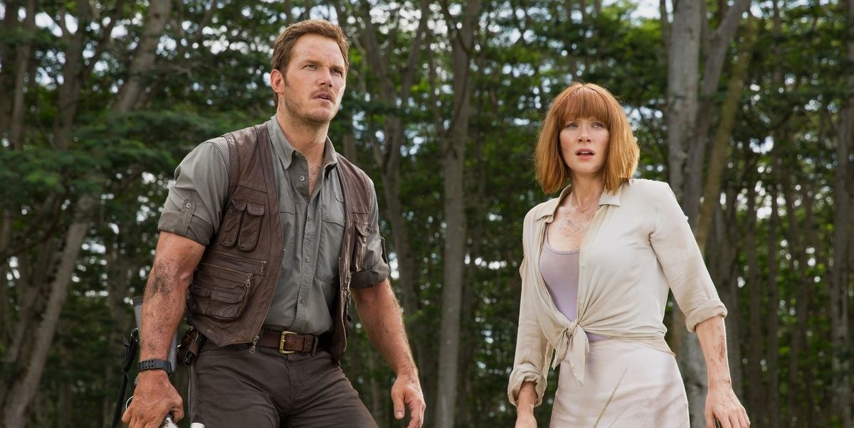 Chris Pratt as Owen and Bryce Dallas Howard as Claire looking off into the distance with fear.