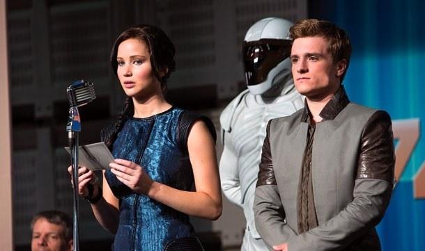 Jennifer Lawrence as Katniss makes a speech with Peeta (Josh Hutcherson) by her side.