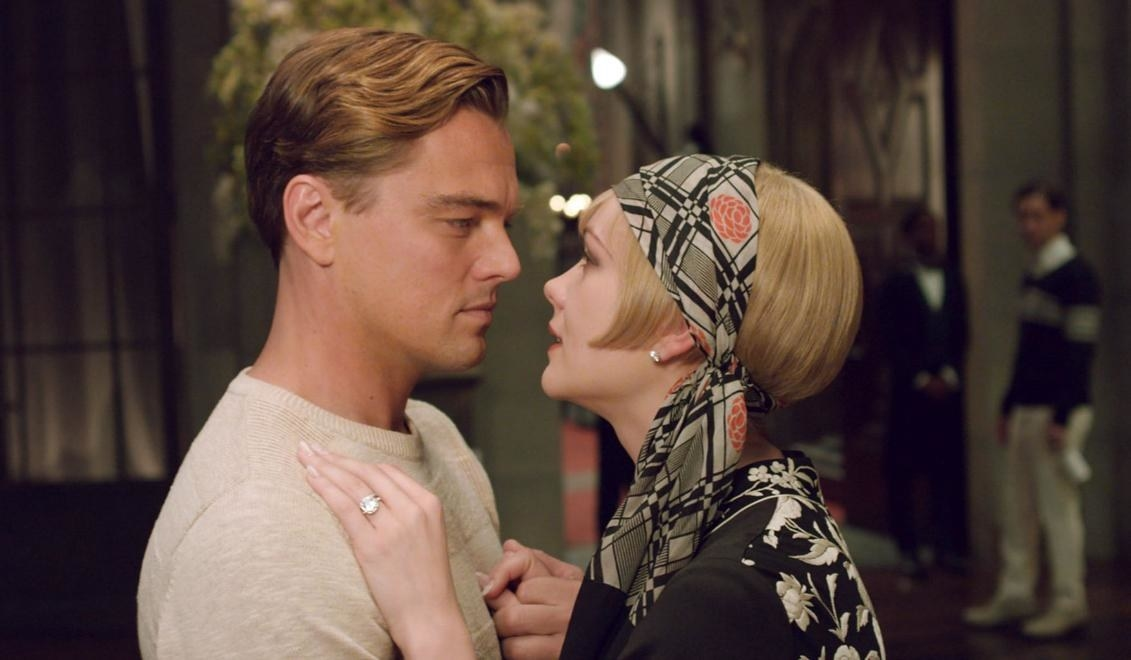 Leonardo DiCaprio as Gatsby embraces Daisy, played by Carey Mulligan.