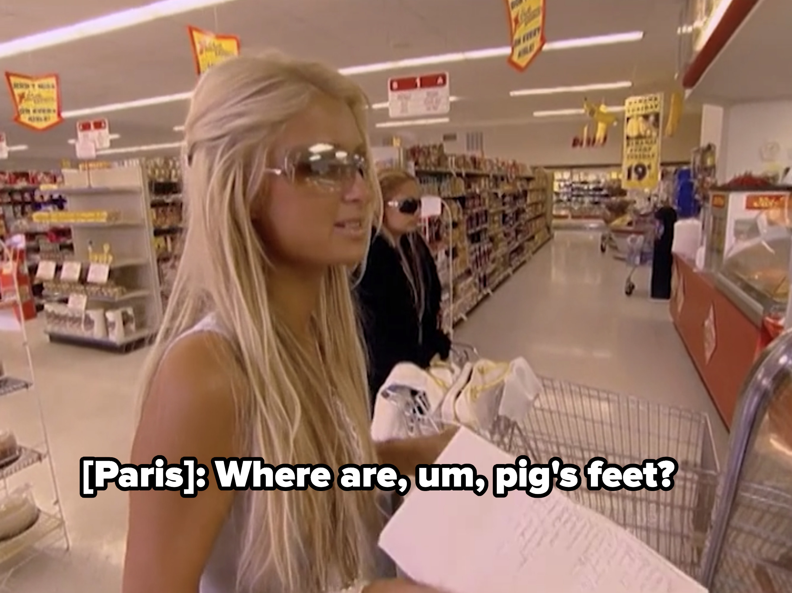 Paris inquiring about the location of pig's feet at the grocery store.