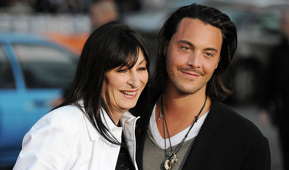 A getty image showing Anjelica Huston hugging her nephew Jack Huston at an event