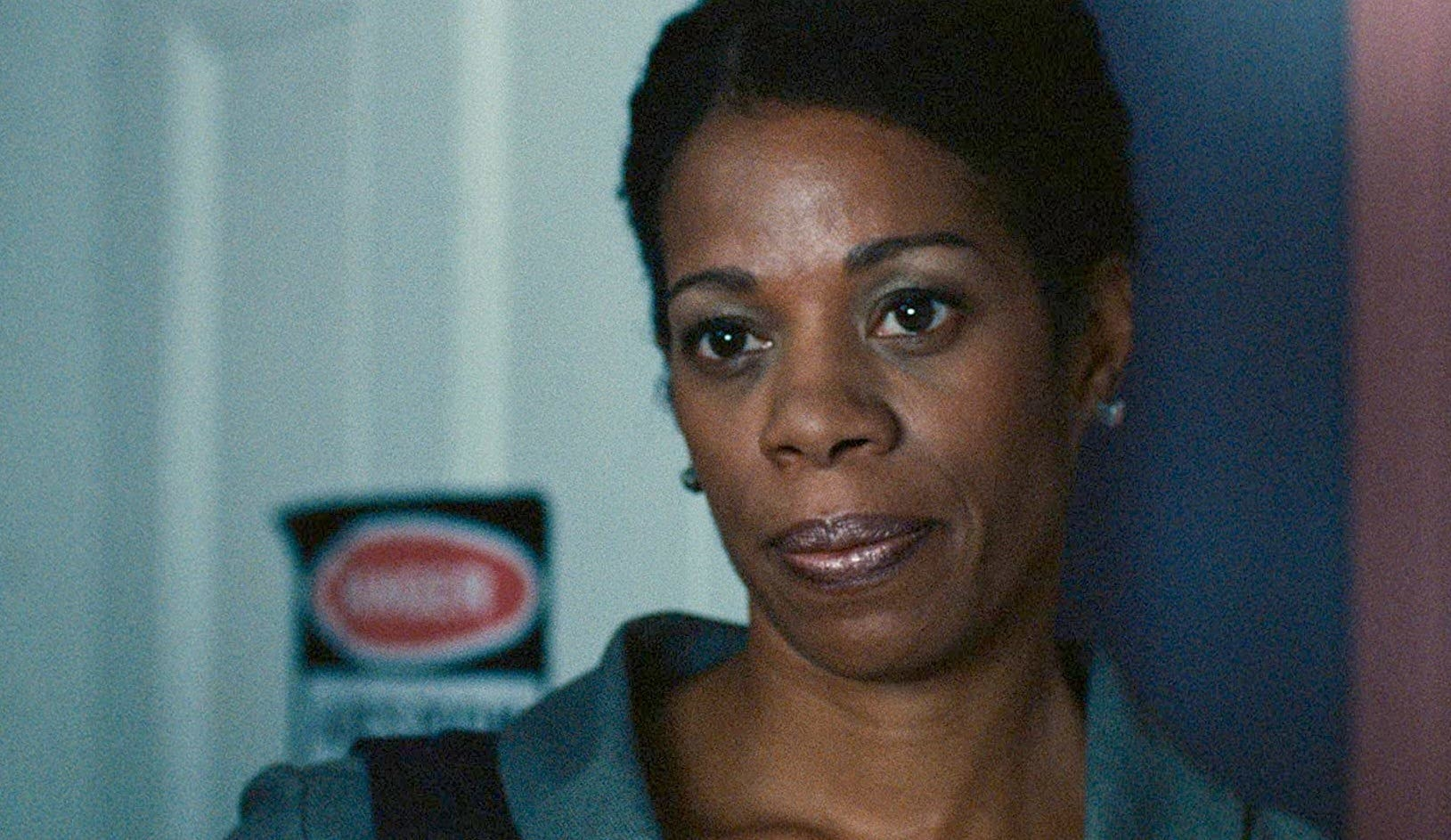 A close up of Kim Wayans looking serious in the movie Pariah