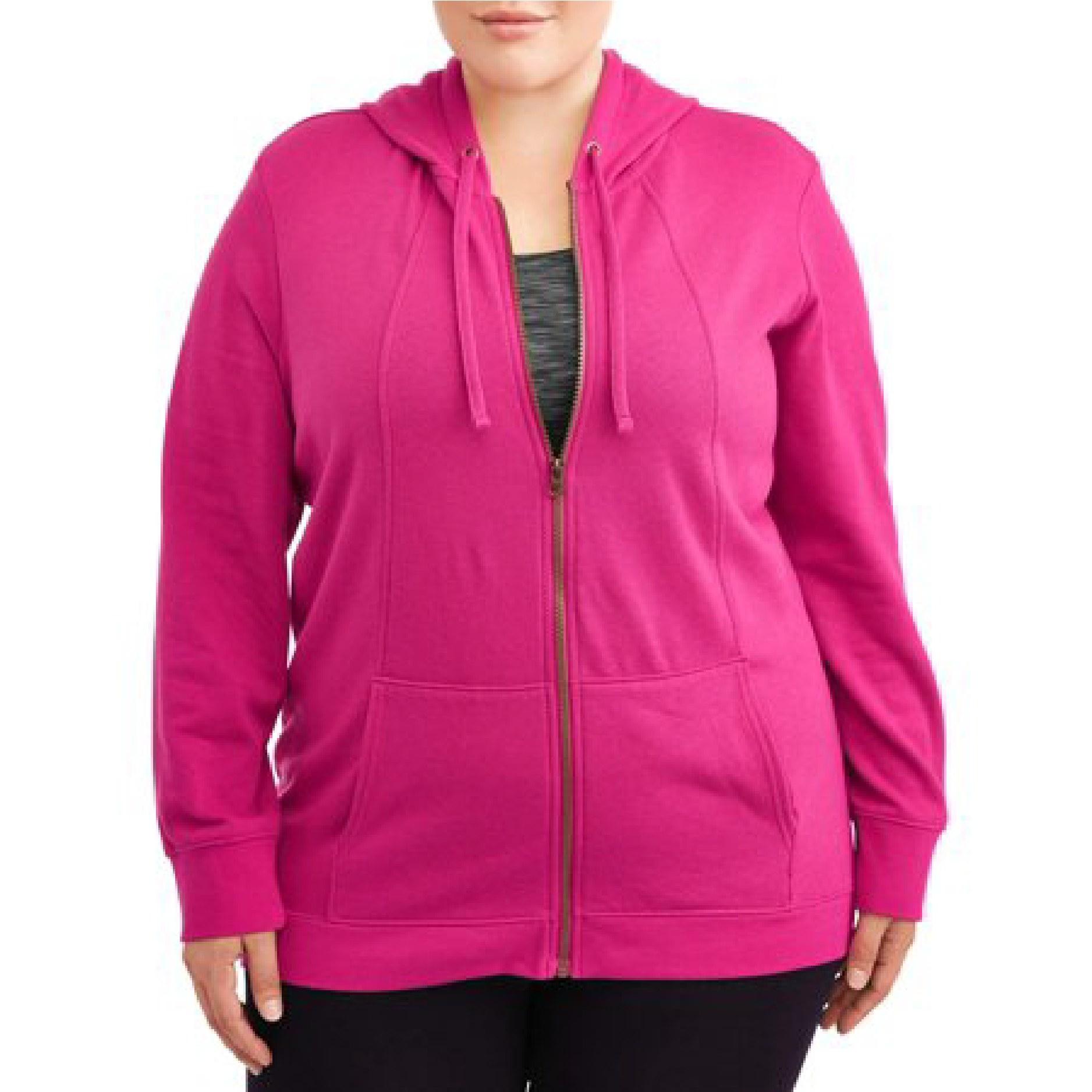 Model wearing the pink zip-up hoodie