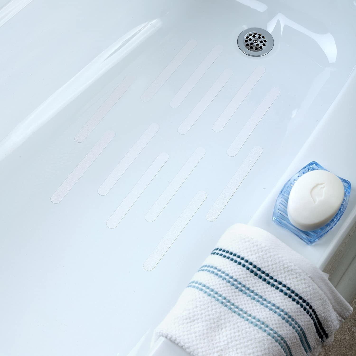 Twelve white lines placed horizontally in the tub to prevent slipping while standing in the bath