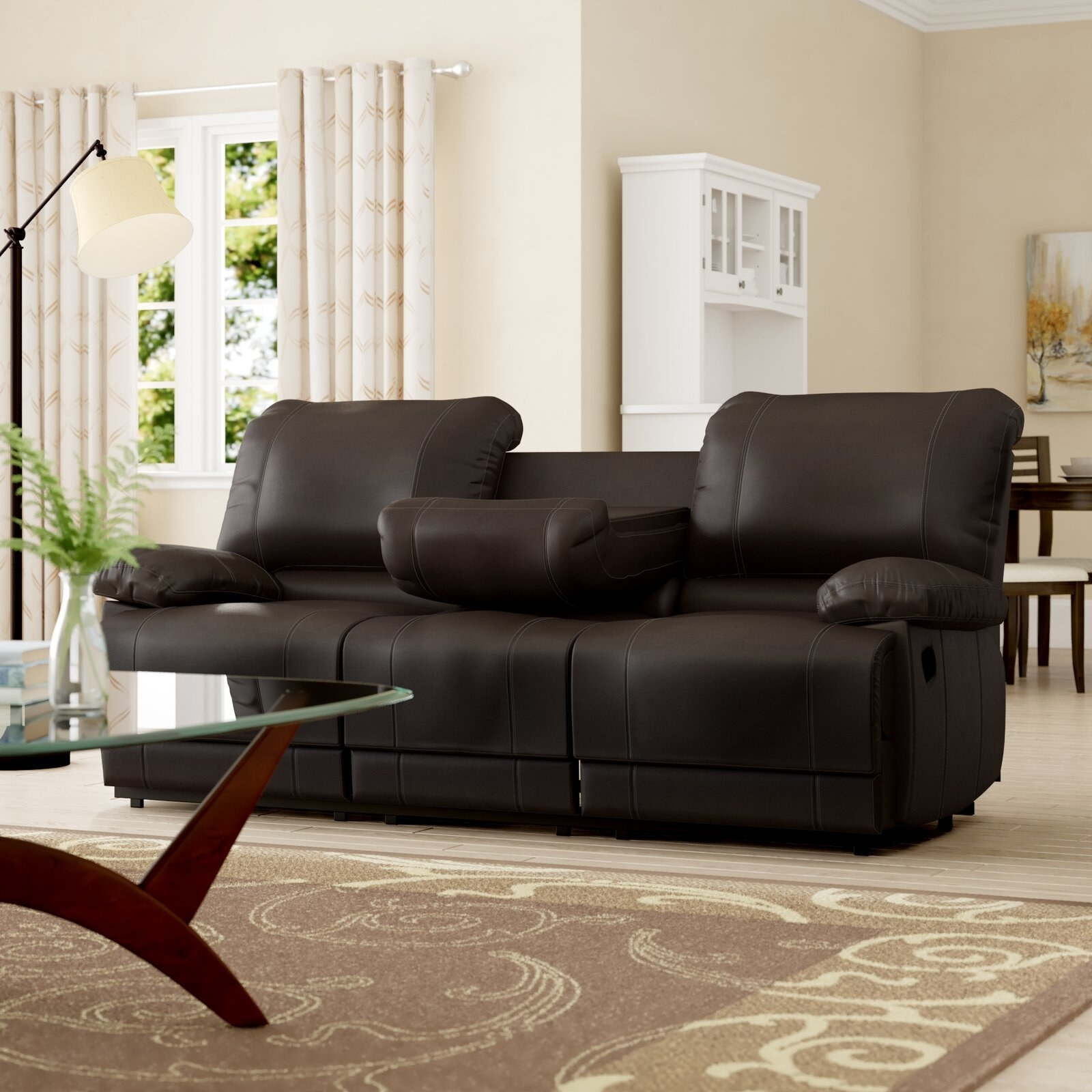Reclining pillow top arm sofa with collapsible center console with built-in cupholders