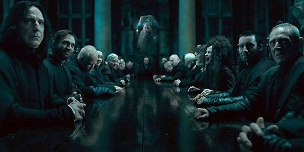 Snape, Bellatrix, the Malfoys, and the rest of the Death Eaters sitting at a long table at Malfoy Manor, listening to Voldemort give orders, while a Hogwarts teacher is being tortured to death in the air