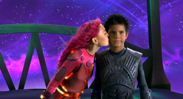 Lavagirl kissing Sharkboy on the cheek