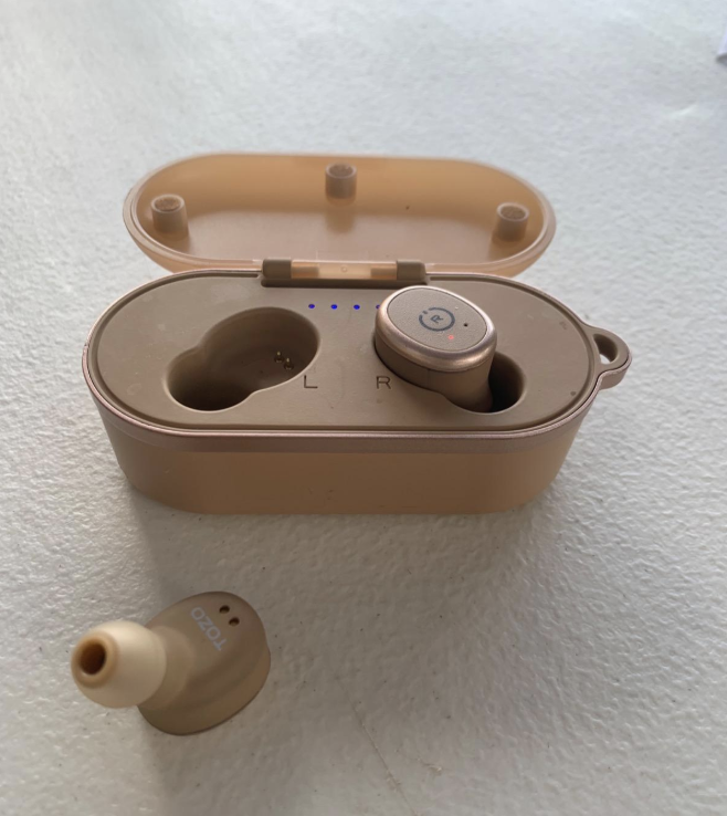 A pair of wireless earbuds in rose gold
