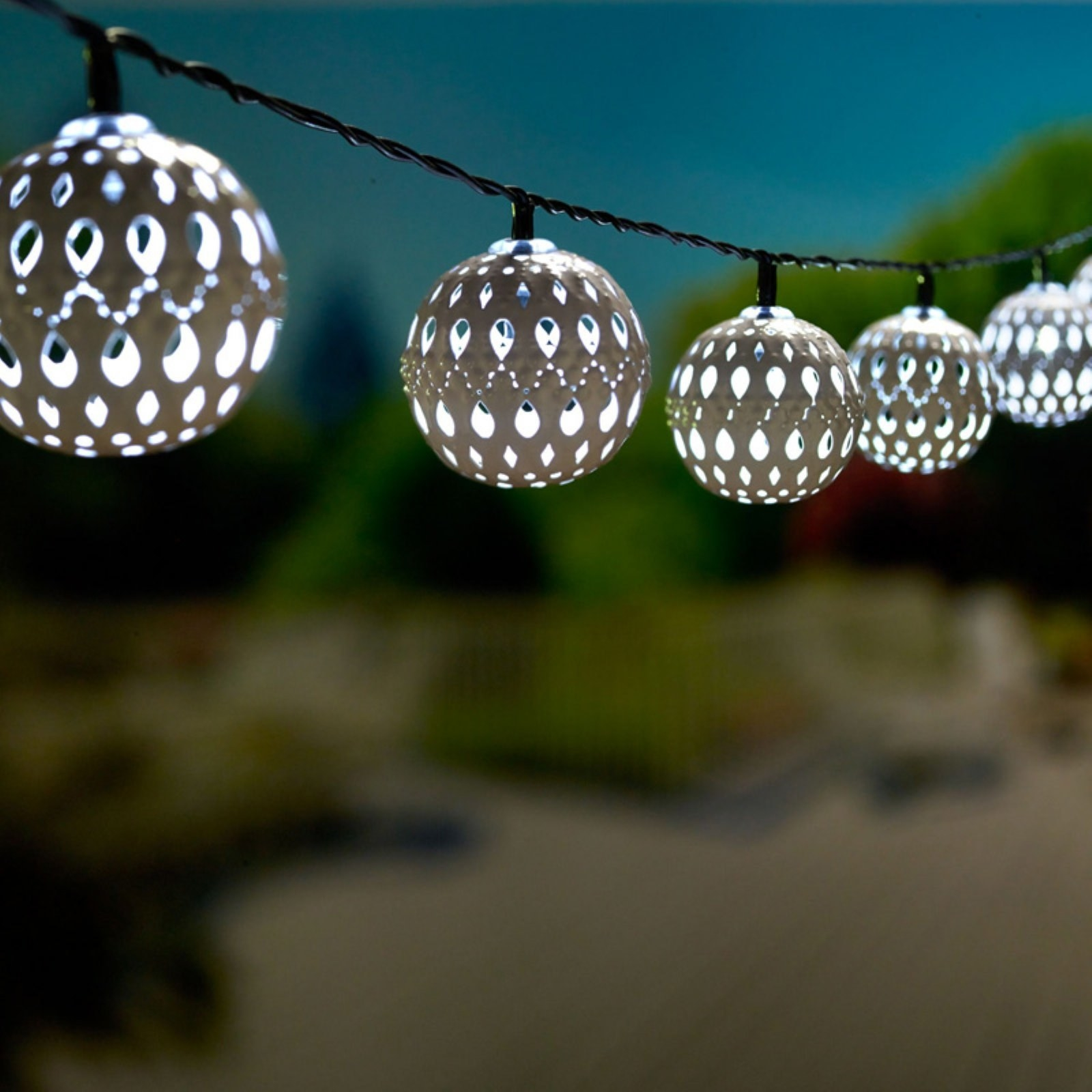 ball string lights with delicate designs on them