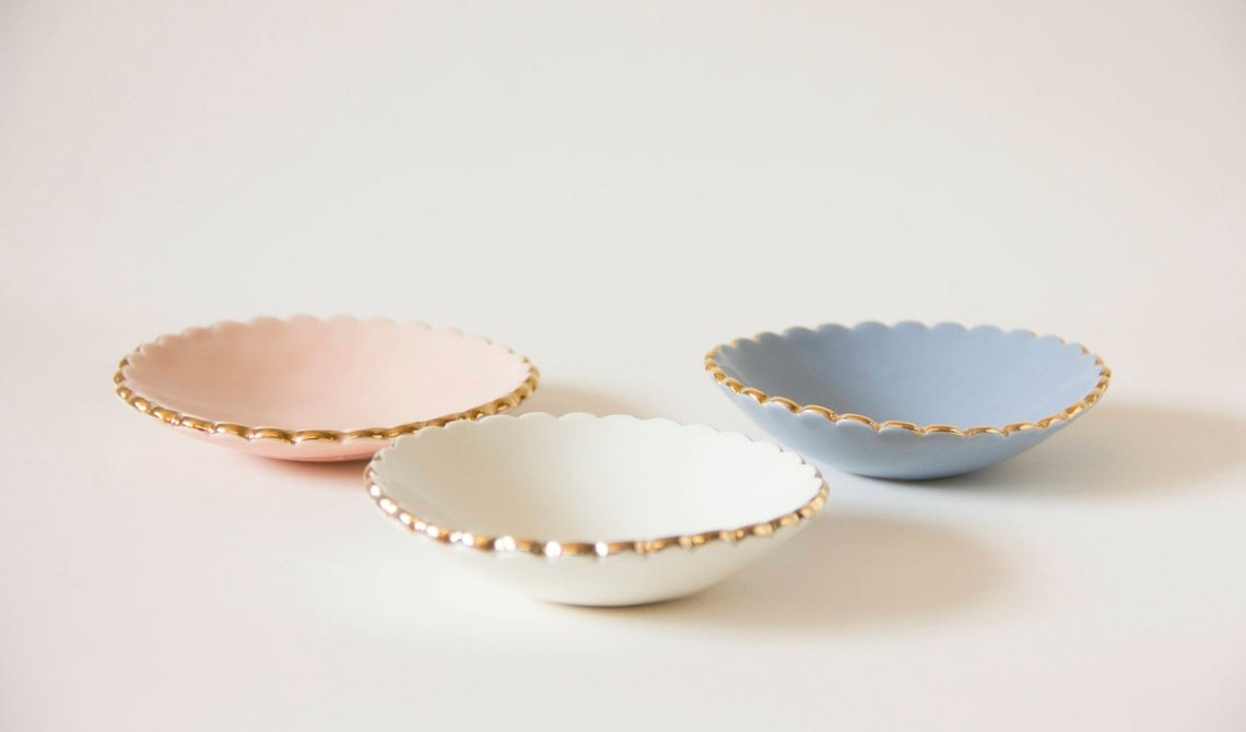 Three small ceramic ring dishes They have a rounded scallop trim
