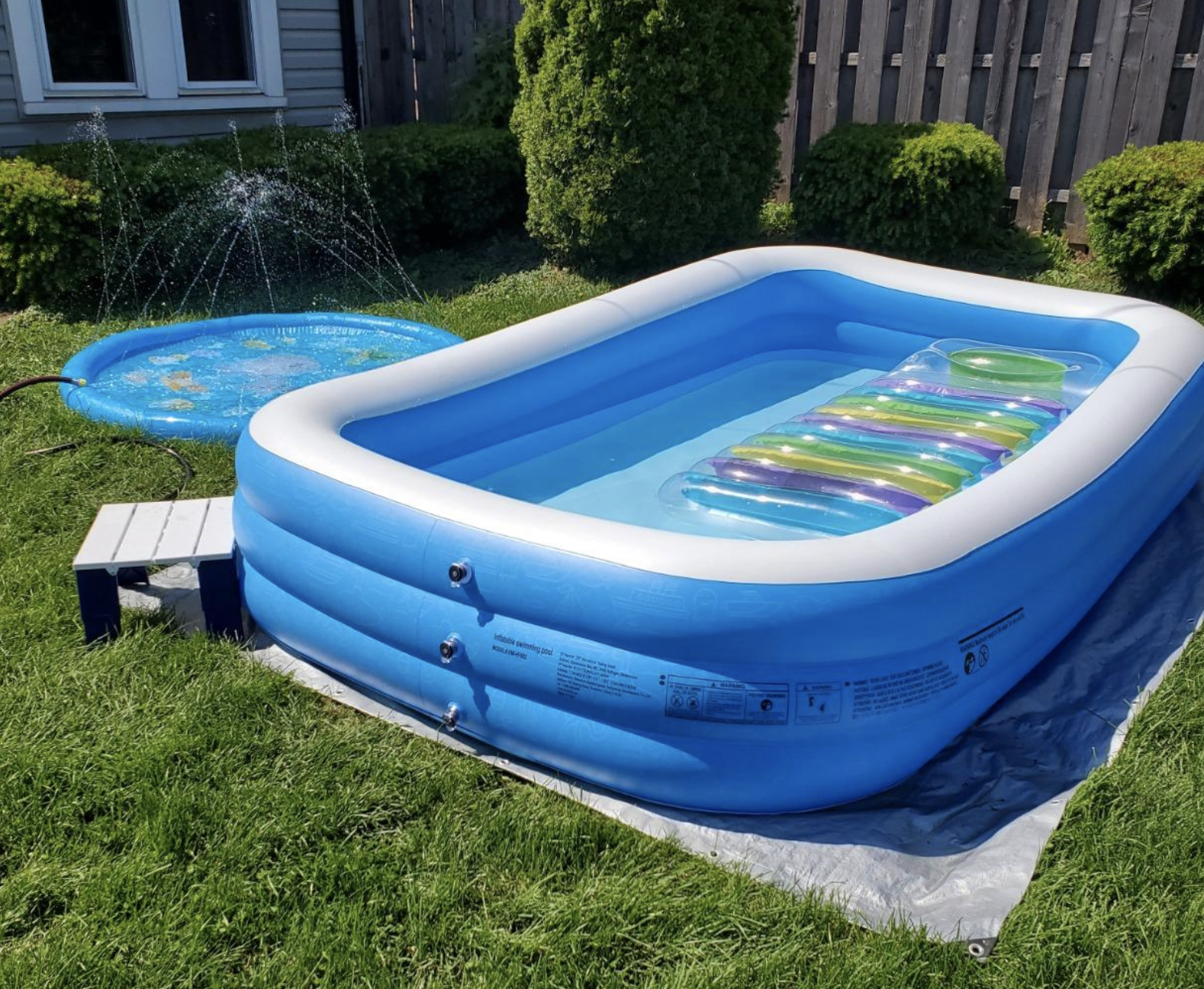 the blue pool filled with water and a float inside