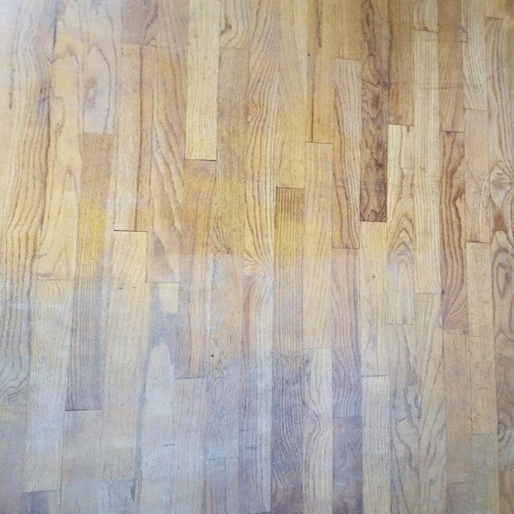 Reviewer's before picture of dull hardwood floor